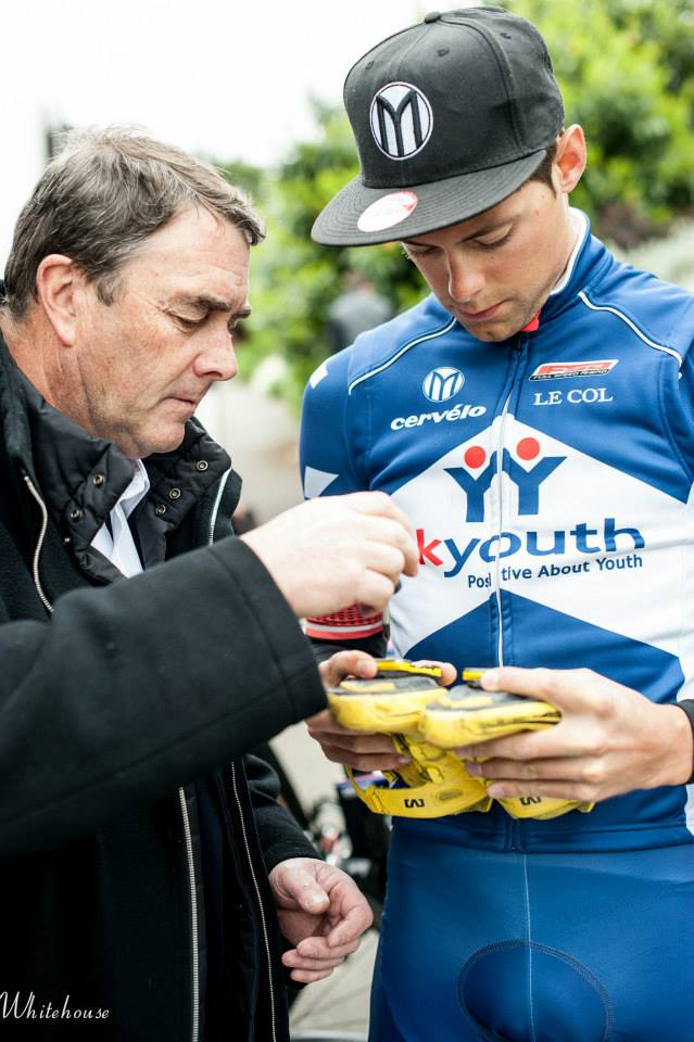Helping teamowner Nigel Mansell adjusting his cleats